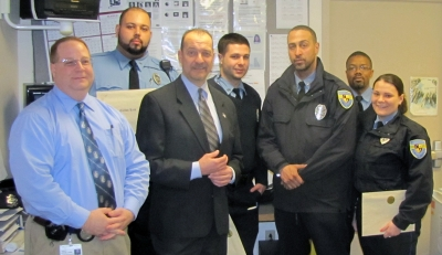 Tracy Myers, Boston Children's Hospital Operation Manager, and Jeff Edmiston,  Senior Vice President of Operations, pose with Longwood Security Officers after a Commendation Ceremony on April 12, 2013. From L-R: Myers, Officer Ruiz, Edmiston, Officer Hussey, Officer Alves, Officer Bobbitt and Officer Jenkins.