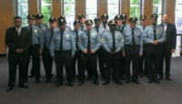 Longwood Security Services Honor Guard leads the procession at Newbury College Commencement Ceremony on May 12, 2013.
